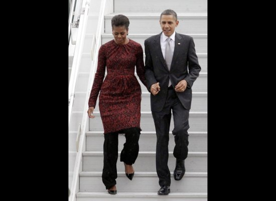 First Lady Michelle Obama wearing a dress with pants via youmademelikeyou.com